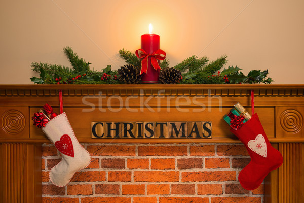Christmas fireplace with stockings and candle Stock photo © RTimages