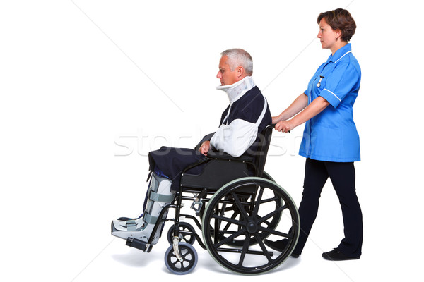 Nurse and injured man in wheelchair isolated Stock photo © RTimages
