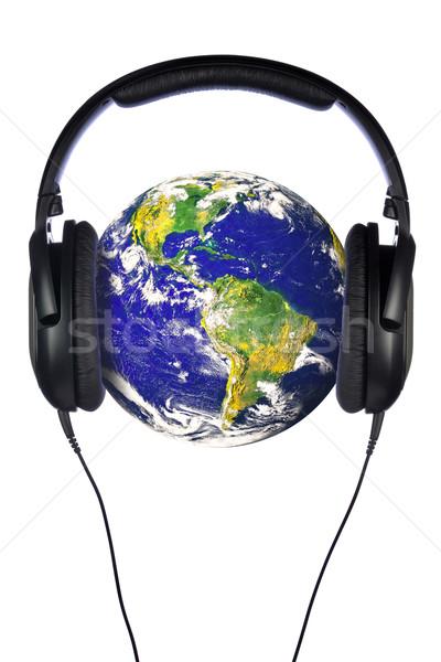 Fejhallgató világ pár földgömb szívesség nyilvános Stock fotó © RTimages