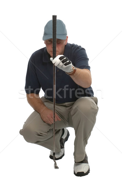 Golfer lining up a putt. Stock photo © RTimages