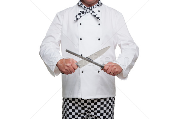 Chef sharpening his knife. Stock photo © RTimages