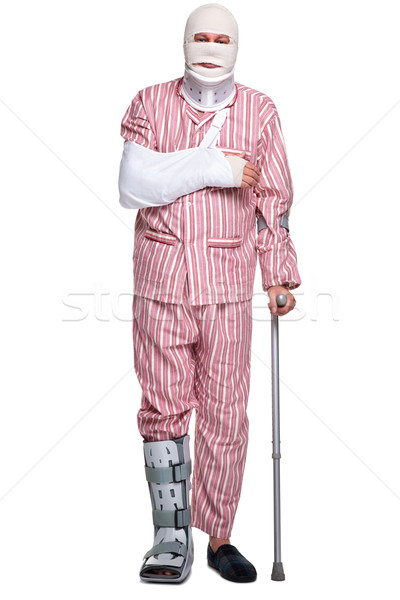 Injured man walking on crutches Stock photo © RTimages