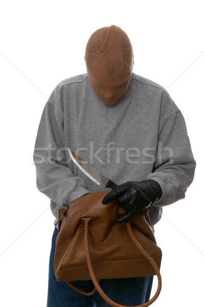 Mugger searching through a handbag. Stock photo © RTimages