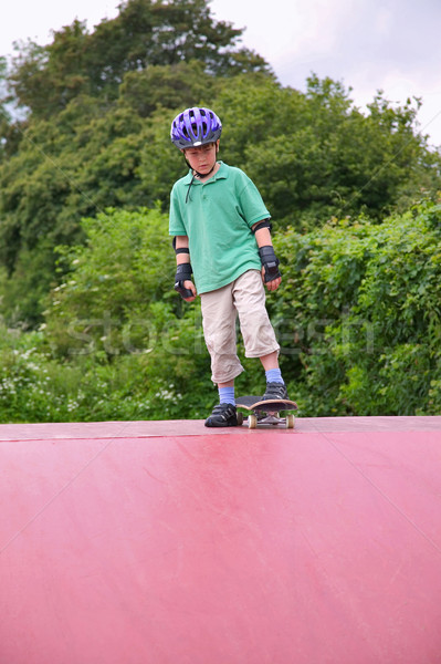 Boy on a skateboard ramp Stock photo © RTimages