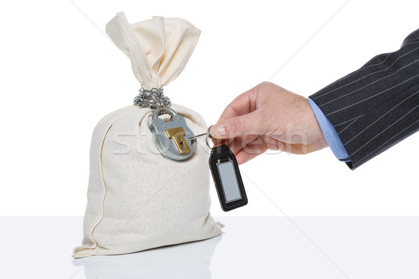 Unlocking a money sack Stock photo © RTimages