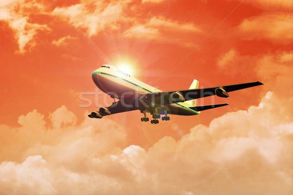 Foto stock: Avião · voador · céu · nuvens · pôr · do · sol · avião