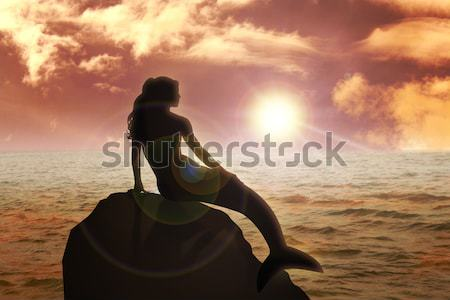 Sereia sessão rocha céu água nuvens Foto stock © rudall30