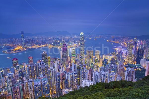 Hong Kong imagem muitos arranha-céus crepúsculo azul Foto stock © rudi1976