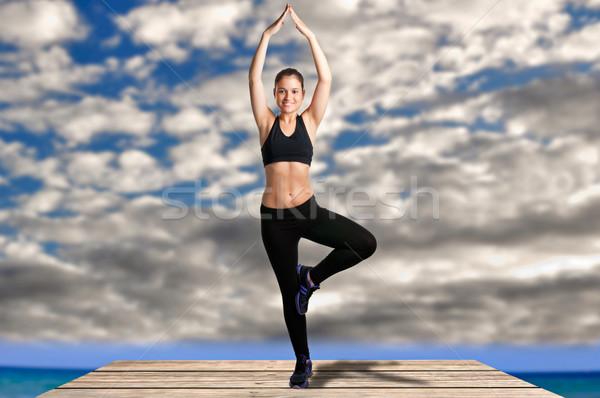 Woman Doing Yoga Stock photo © ruigsantos