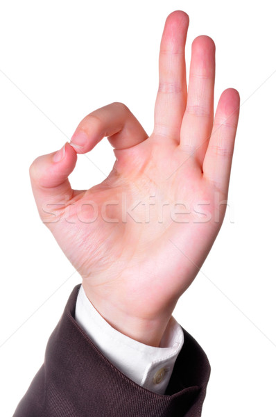 Hand in a suit making the OK sign isolated in white background Stock photo © ruigsantos