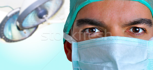 Surgeon with face mask Stock photo © ruigsantos