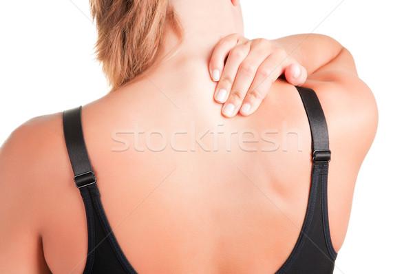 Dor nas costas mulher jovem dor de volta pescoço mulher Foto stock © ruigsantos