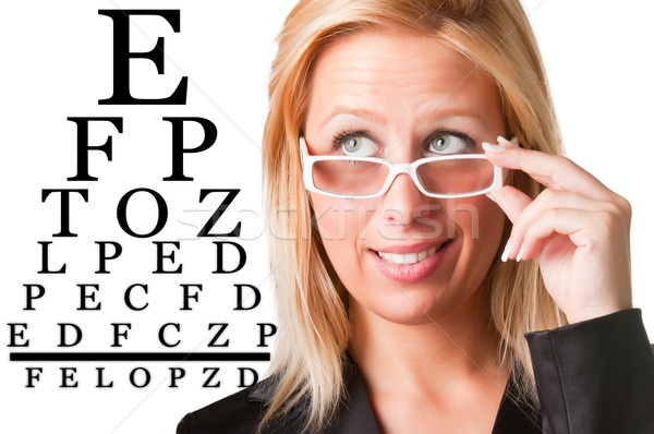 Wondering Businesswoman Looking at an eyechart Stock photo © ruigsantos
