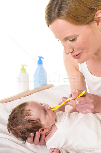 Mother with infant and spoon Stock photo © runzelkorn