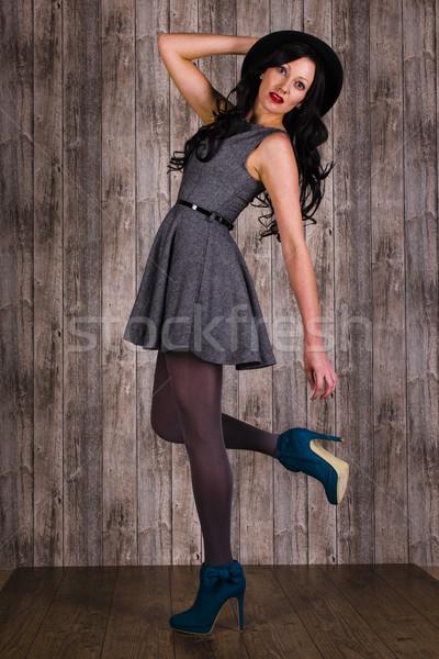 Poz zarif genç kadın uzun koyu renk saçları Stok fotoğraf © runzelkorn