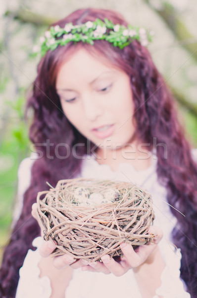 Girl with bird nest Stock photo © runzelkorn