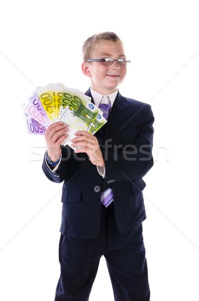 Gyerek menedzser pénz tizenéves fiú visel sötét Stock fotó © runzelkorn