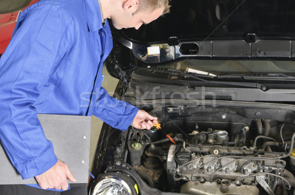Auto mechanic check a car engine Stock photo © runzelkorn