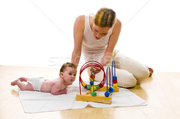 Mama újszülött baba anya játszik padló Stock fotó © runzelkorn