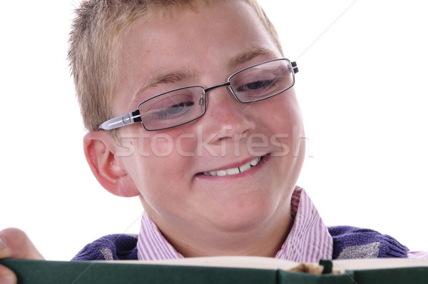Olvas szőke tizenéves fiú szemüveg asztal tele Stock fotó © runzelkorn