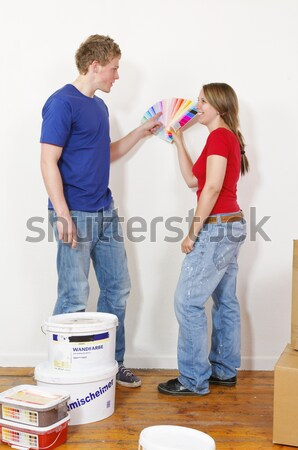 Young couple mixed together on the wall color Stock photo © runzelkorn