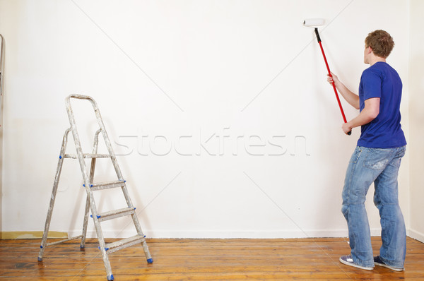 Young couple paint on renovation and Stock photo © runzelkorn