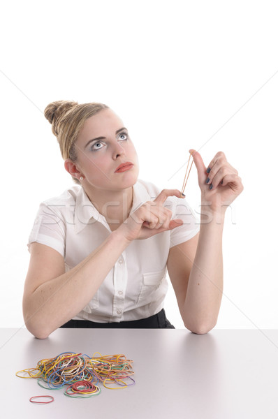 Bored at the office, play with rubber band Stock photo © runzelkorn