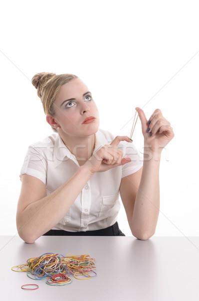 Vervelen kantoor spelen elastiekje jonge vrouw blond Stockfoto © runzelkorn