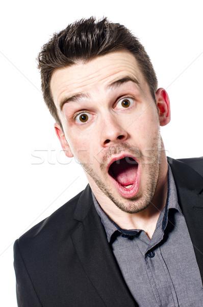 Portré meglepett üzletember fiatal öltöny néz Stock fotó © runzelkorn