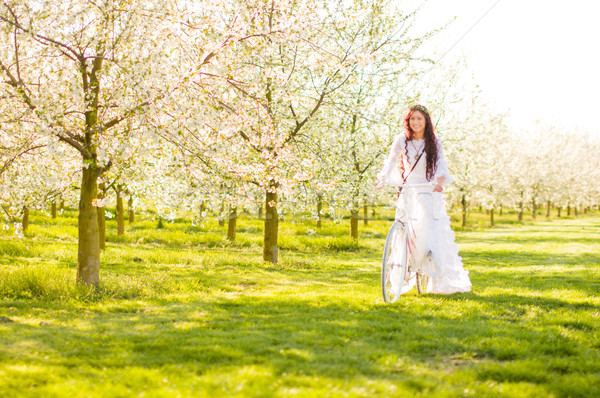 Lány cseresznyevirág hippi fehér ruha virágmintás koszorú Stock fotó © runzelkorn