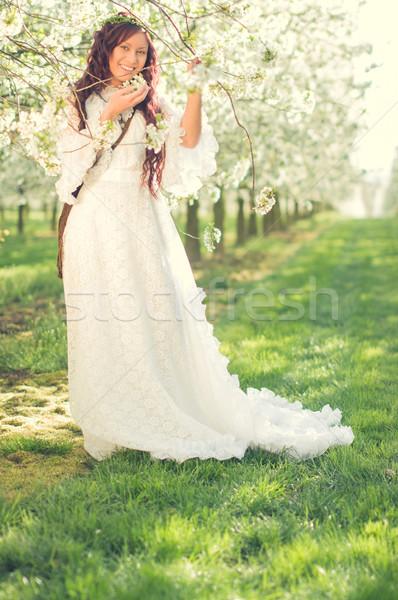 Lány cseresznyevirág fiatal nő visel hosszú fehér ruha Stock fotó © runzelkorn