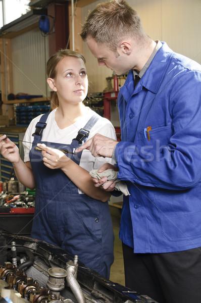 Apprentice and master in garage Stock photo © runzelkorn