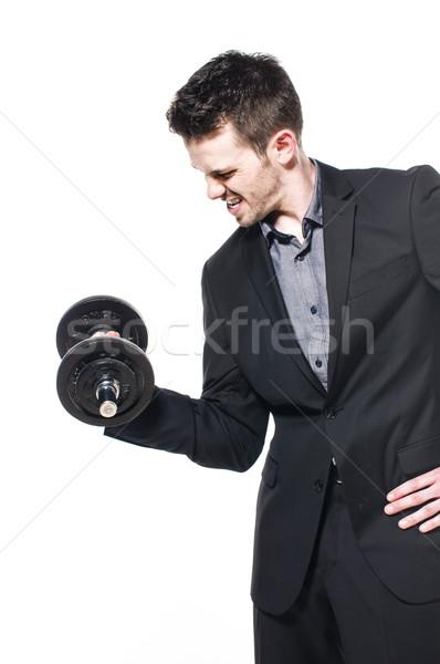 Erő fiatal férfi üzletember fény öltöny Stock fotó © runzelkorn