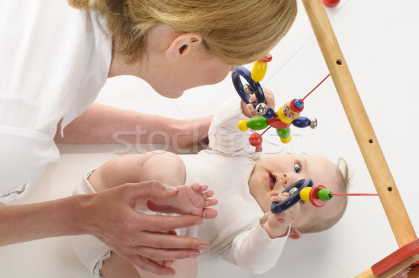Mutter spielt mit Saeugling Stock photo © runzelkorn