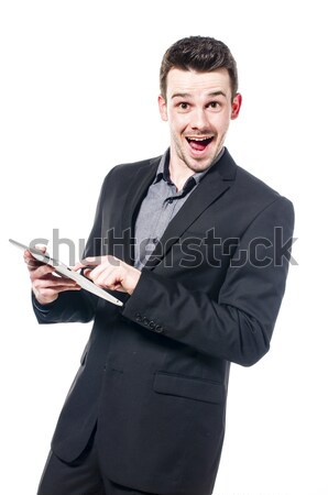 üzletember táblagép fiatal öltöny gépel táblagép Stock fotó © runzelkorn