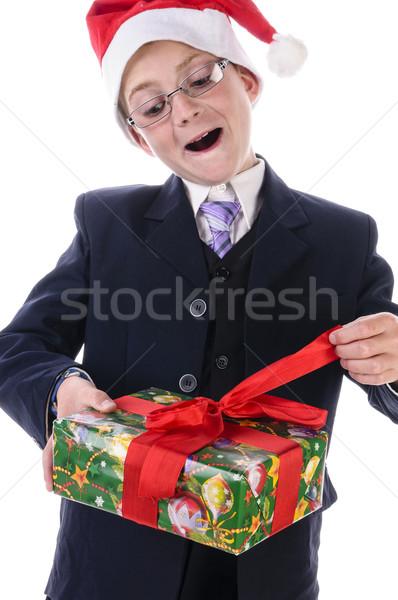 Kicsi fiú ajándék tizenéves fiú visel fekete öltöny Stock fotó © runzelkorn