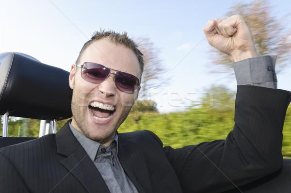 Sikeres üzletember fiatalember öltöny lovaglás nyitva Stock fotó © runzelkorn
