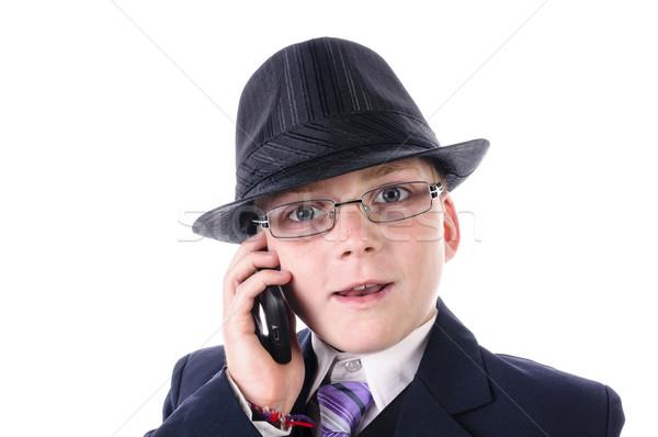 Portré kicsi fiú fekete öltöny telefon visel Stock fotó © runzelkorn