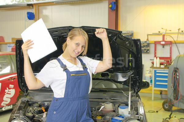 Female car mechanic has passed the exam and is happy. Stock photo © runzelkorn
