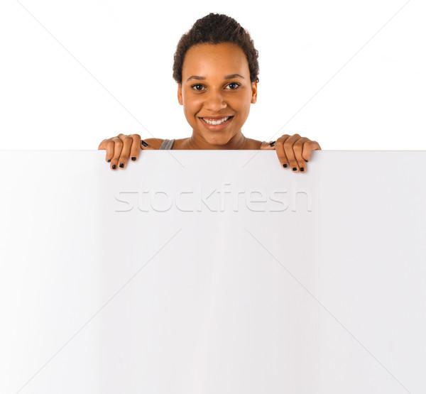 Young girl holding a banner Stock photo © runzelkorn