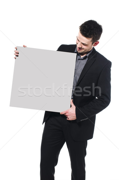 Eladó okos üzletember magasra tart üres tábla izolált Stock fotó © runzelkorn