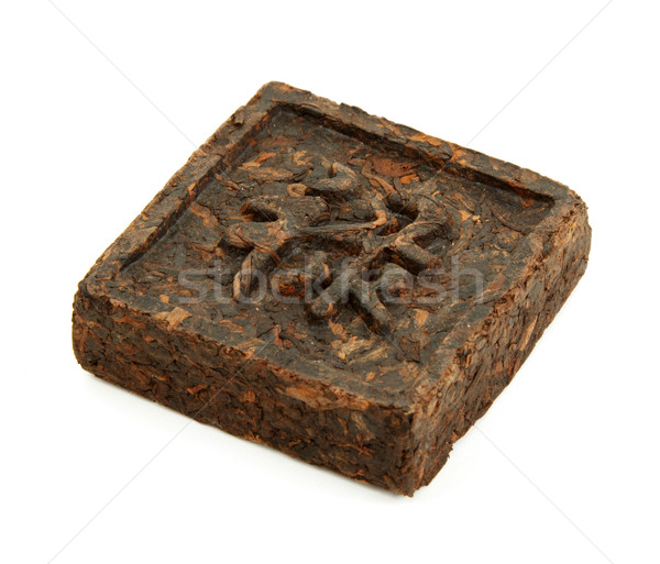 Pressed briquette of green tea with hieroglyphic on white backgr Stock photo © RuslanOmega