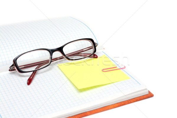Spectacles on note pad Stock photo © RuslanOmega