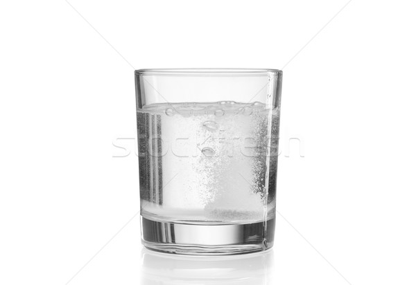 Fizzy tablet in glass of water. Stock photo © RuslanOmega