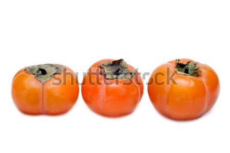 Three persimmons put in row Stock photo © RuslanOmega