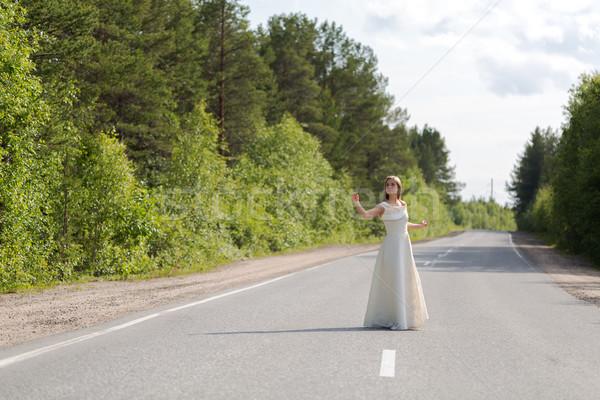 Ragazza abito strada abito bianco faccia erba Foto d'archivio © RuslanOmega