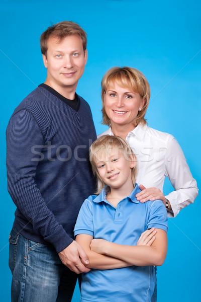 счастливая семья отец матери сын синий женщину Сток-фото © RuslanOmega