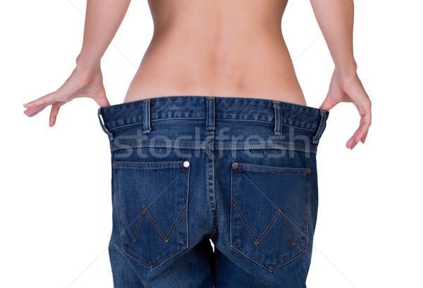 Szczupły dziewczyna duży dżinsy kobieta kobiet Zdjęcia stock © RuslanOmega