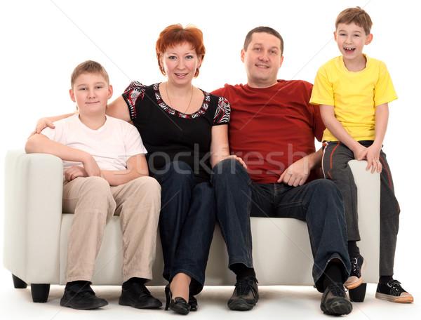 семьи четыре диван белый женщину человека Сток-фото © RuslanOmega