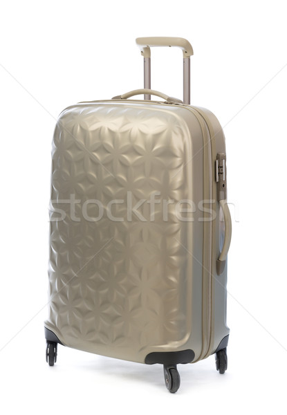 Beige plastic suitcase on wheels for travel. Stock photo © RuslanOmega
